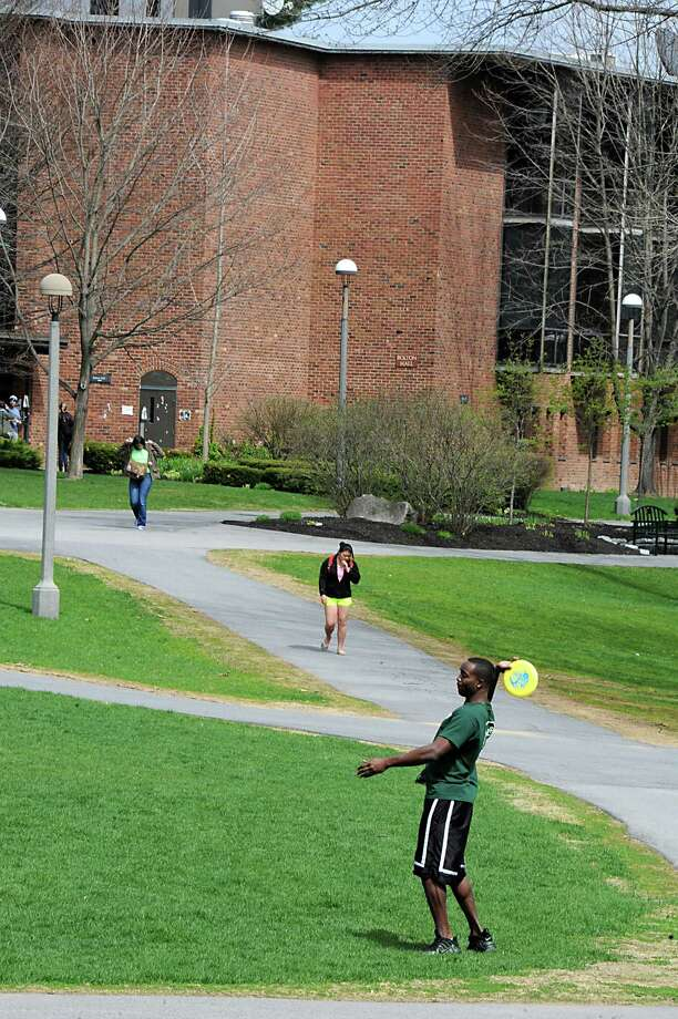 Students walk and play frisbee on the Skidmore College campus on Tuesday May 6, 2014 in Saratoga Springs, N.Y.  (Lori Van Buren / Times Union) Photo: Lori Van Buren / 00026780A