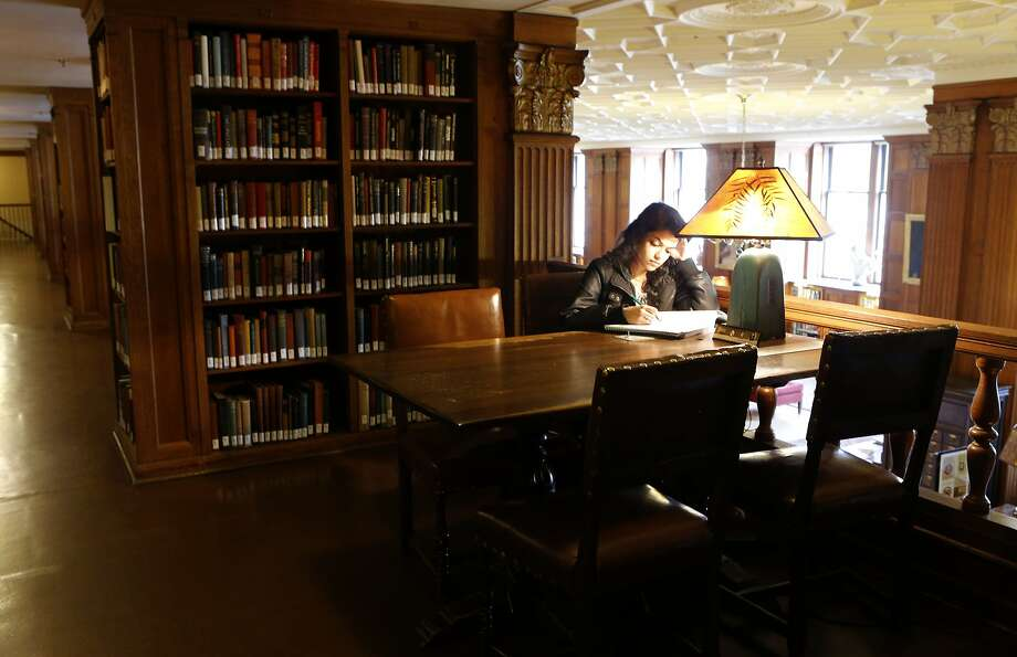 Urvashi Betarbet studies in a library at UC Berkeley. A Standard & Poor's report suggests increasing educational opportunities to boost economic growth. Photo: Michael Macor, The Chronicle