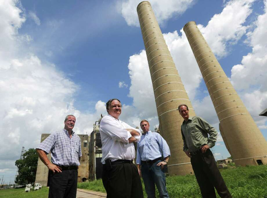 From left, Larry Ward, Steve McGuire, Tyler White and Dave Forster see big promise in small plants that Biofuels Power Corp. plans to use to convert natural gas to liquids. Photo: Billy Smith II, Staff / © 2014 Houston Chronicle