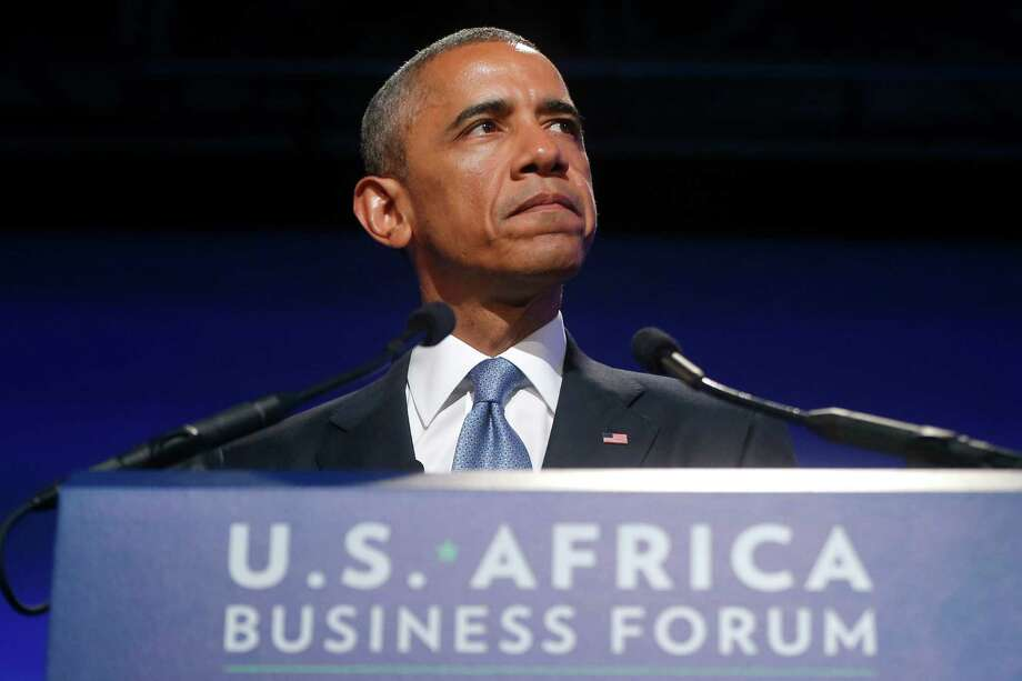 President Barack Obama pauses as he speaks at the US Africa Business Forum during the US Africa Leaders Summit, Tuesday, Aug. 5, 2014, at the Mandarin Oriental Hotel in Washington. African heads of state are gathering in Washington for an unprecedented summit to promote business development. (AP Photo/Charles Dharapak) Photo: Charles Dharapak, STF / AP