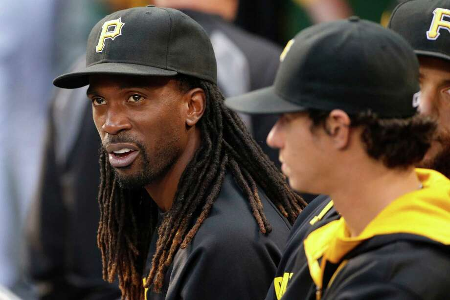 Pittsburgh Pirates' Andrew McCutchen, left, sits in the dugout next to Jeff Locke during the second inning of a baseball game against the Miami Marlins in Pittsburgh on Tuesday, Aug. 5, 2014. McCutchen is out with a rib injury. (AP Photo/Gene J. Puskar) Photo: Gene J. Puskar, STF / AP