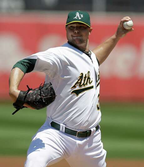 The Athletics acquired Jon Lester to be a mainstay in the playoffs but also will need him to try to hold off the Angels in the AL West. Photo: Ben Margot, STF / AP