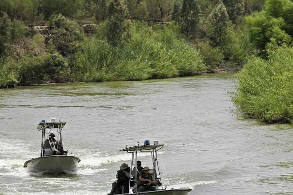 U.S. Border Patrol boats ride the Rio Grande by the McAllen pump in Hidalgo, County, Texas, Thursday, July 24, 2014. It is part of the Rio Grande Sector, an area that has seen an increase of unaccompanied minor Central American immigrants crossing in recent months. According to sector Chief Border Patrol Agent Kevin W. Oaks, his sector currently has 3,234 agents, and 191 support staff. In the past 18 months, they have added 500 new agents, and will add roughly 300 more through the end of this year.