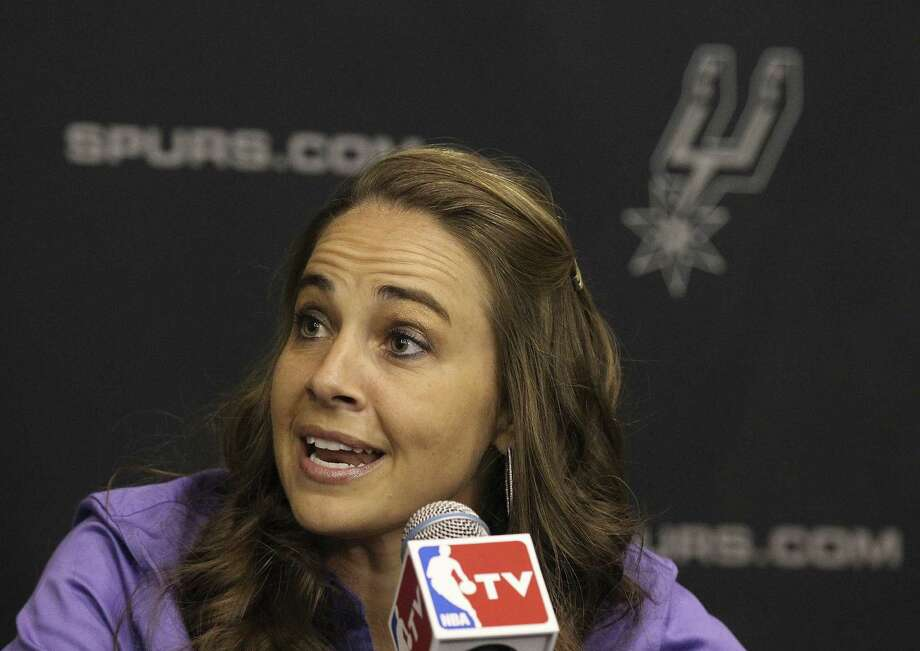 1. Becky Hammon became the first female full-time, paid assistant coach in the NBA after she was hired by the Spurs on Aug. 5, 2014. She is also the first full-time female coach in any North American male professional sports league. Photo: Kin Man Hui / San Antonio Express-News / ©2014 San Antonio Express-News