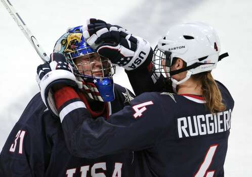VANCOUVER, BC - FEBRUARY 18:  Jessie Vetter of the United States celebrates with Angela Ruggiero of the United States after they won the ice hockey women's preliminary game between USA and Finland on day 7 of the 2010 Vancouver Winter Olympics at UBC Thunderbird Arena on February 18, 2010 in Vancouver, Canada.  (Photo by Harry How/Getty Images) *** Local Caption *** Jessie Vetter;Angela Ruggiero Photo: Harry How, Getty Images / 2010 Getty Images