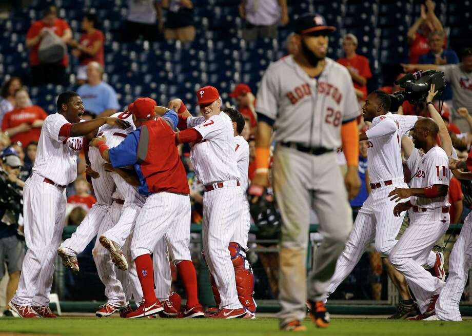 To the dismay of Astros first baseman Jon Singleton (28), the Phillies walked off winners at the end of Tuesday night's five-hour and five-minute game. Photo: Matt Slocum, STF / AP
