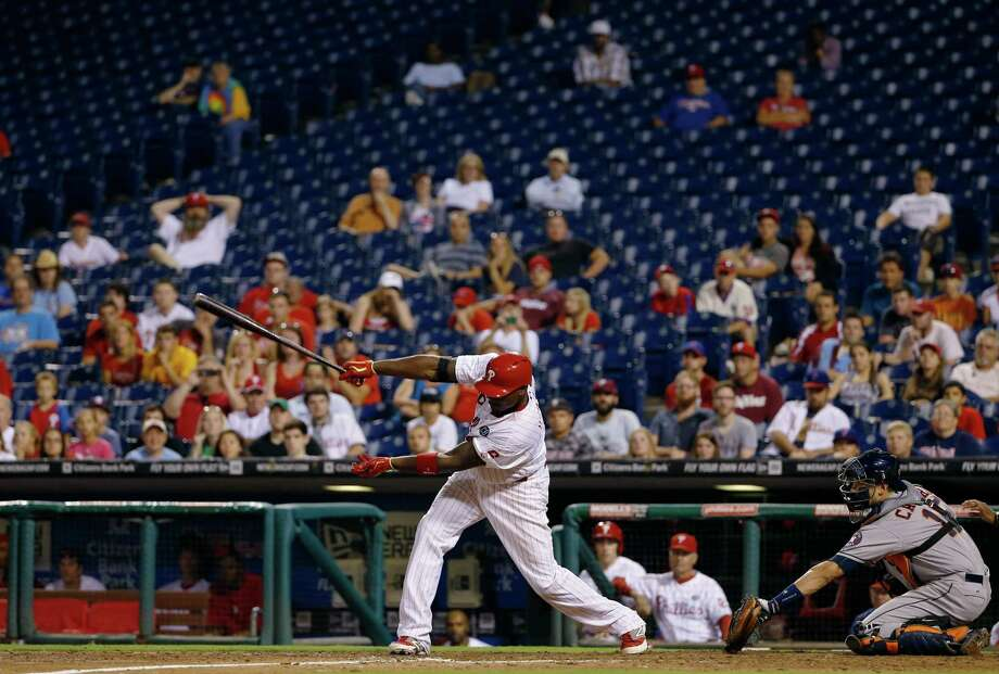 The crowd was sparse when the Phillies' Ryan Howard stroked the game-winning single in the 15th inning, ending Tuesday night's game after five hours and five minutes. Photo: Matt Slocum, STF / AP