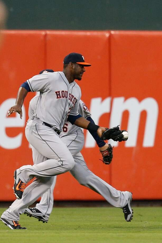 Chris Carter catches a long fly ball hit by Cody Asche. Photo: Brian Garfinkel, Getty Images