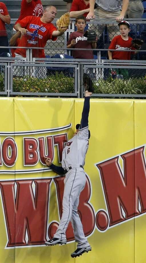 Astros center fielder Jake Marisnick cannot reach a home run by Ryan Howard during the second inning. Photo: Matt Slocum, Associated Press