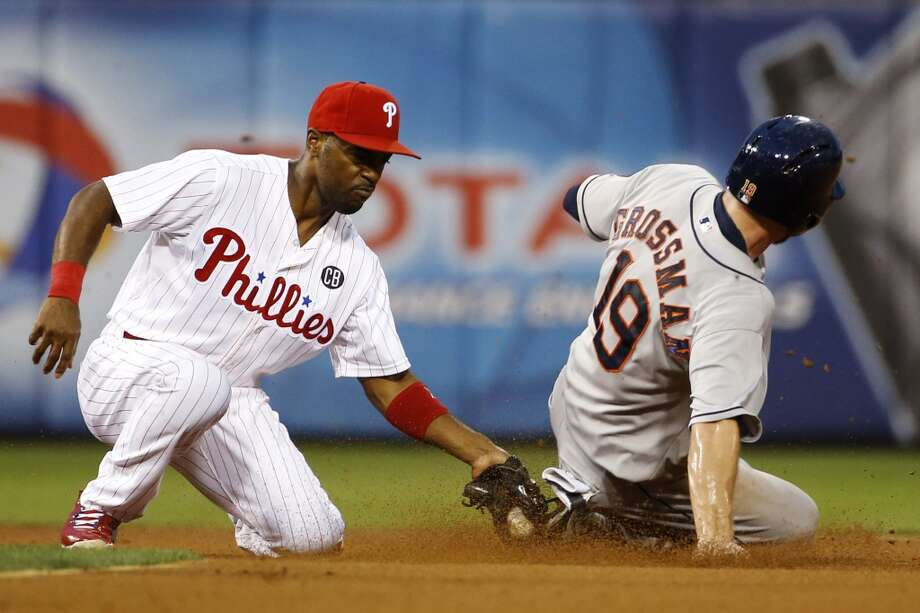 Robbie Grossman, right, is tagged out by Phillies shortstop Jimmy Rollins after trying to steal second. Photo: Matt Slocum, Associated Press