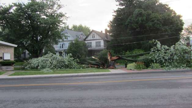 A downed tree at the intersection of Whitehall Road and Ten Eyck Street in Albany awaits removal Wednesday, the day after it was knocked down by a punishing thunderstorm that hit parts of northern Albany County. (Bob Gardinier / Times Union)