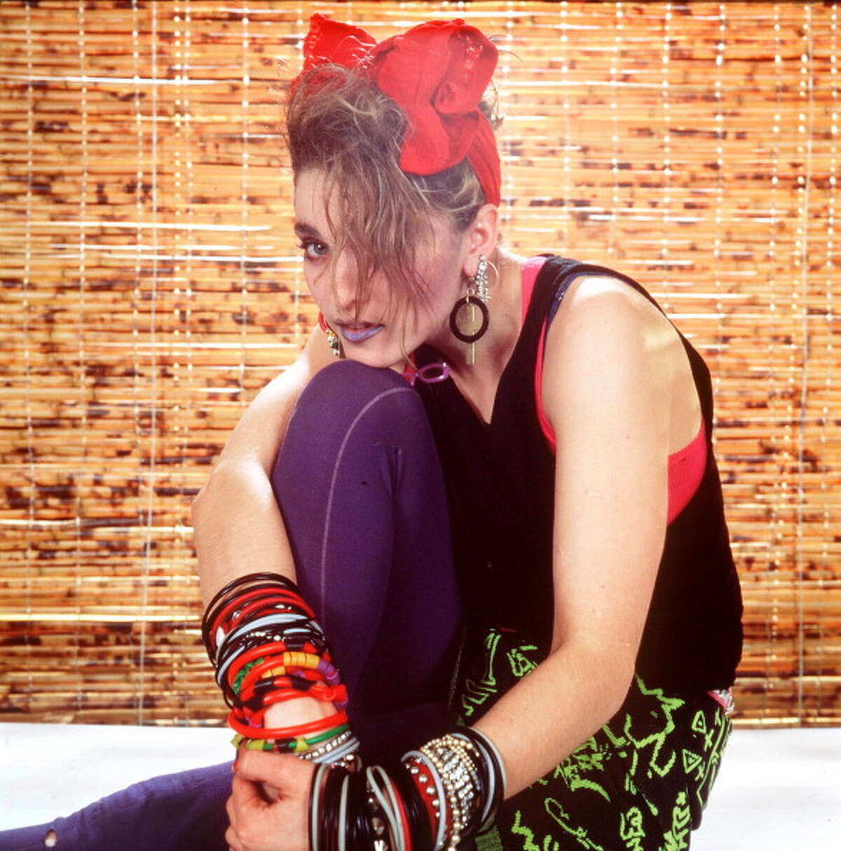 1984 - Madonna strikes a pose in NYC, rocking the '80s thrift-shop, club-kid look.