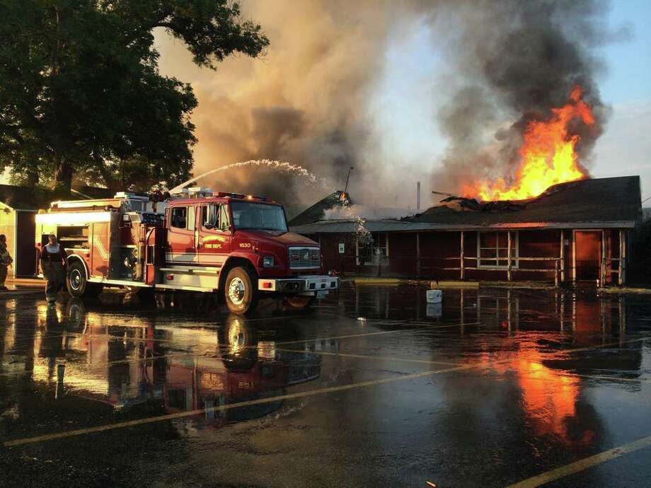 A beloved stop on the Texas barbecue trail, Hinze's BBQ just outside Wharton suffered a devastating fire on Monday evening just before dinner rush. No one was hurt in the blaze, which began with an out of control pit fire, but the building is said to be total loss. Photo: Wharton County Constables Office Precinct 2