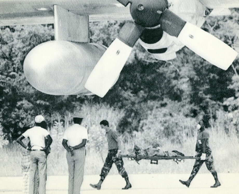 US military personnel carry the remains of a victim of an August 1989 Ethiopian plane crash that killed Rep. Mickey Leland and 15 others. Mickey Leland, a Democratic congressman from Texas 18th District, died Aug. 7, 1989 at age 44 when a plane he was on crashed during a mission trip in Fugnido, Ethiopia. Photo: Houston Chronicle File Photo