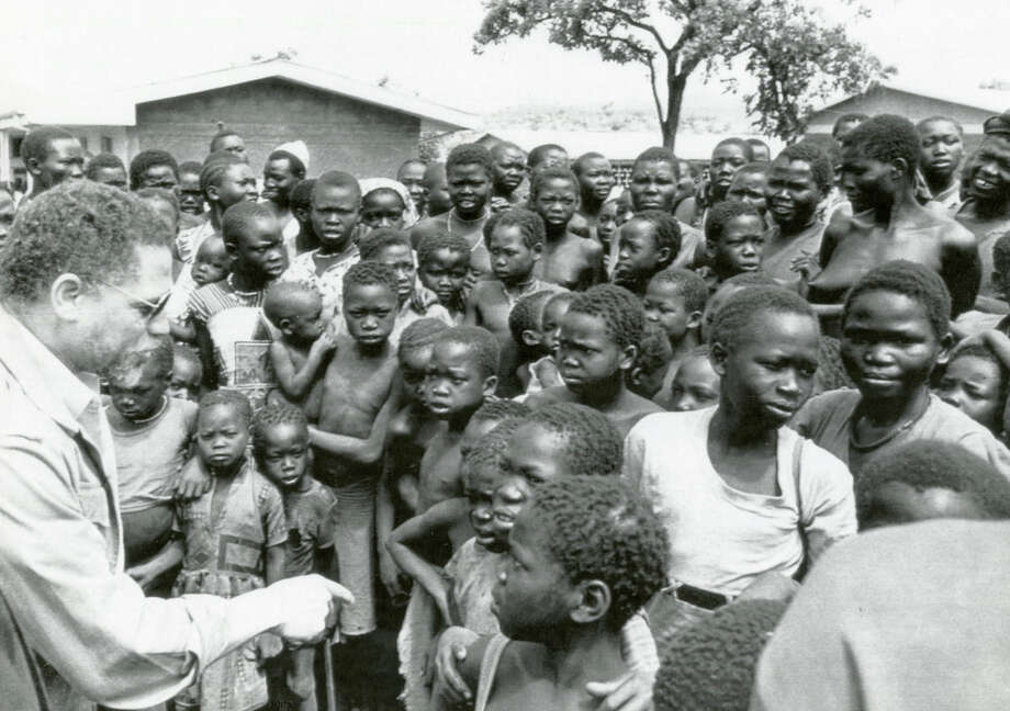 NAIROBI, KENYA – Rep. Mickey Leland talks with refugees of the fighting in Sudan during an April 1989 hunger relief delegation trip to Ethiopia. Mickey Leland, a Democratic congressman from Texas 18th District, died Aug. 7, 1989 at age 44 when a plane he was on crashed during a mission trip in Fugnido, Ethiopia. Photo: Houston Chronicle File Photo