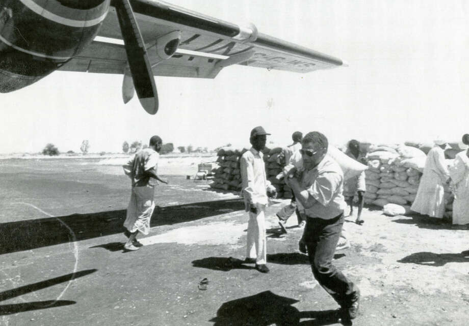 NAIROBI, KENYA - Rep. Mickey Leland helps load 100-pound grain sacks aboard a United Nations aircraft in April 1989 in Sudan during a hunger relief committee delegation visit. Mickey Leland, a Democratic congressman from Texas 18th District, died Aug. 7, 1989 at age 44 when a plane he was on crashed during a mission trip in Fugnido, Ethiopia. Photo: Houston Chronicle File Photo