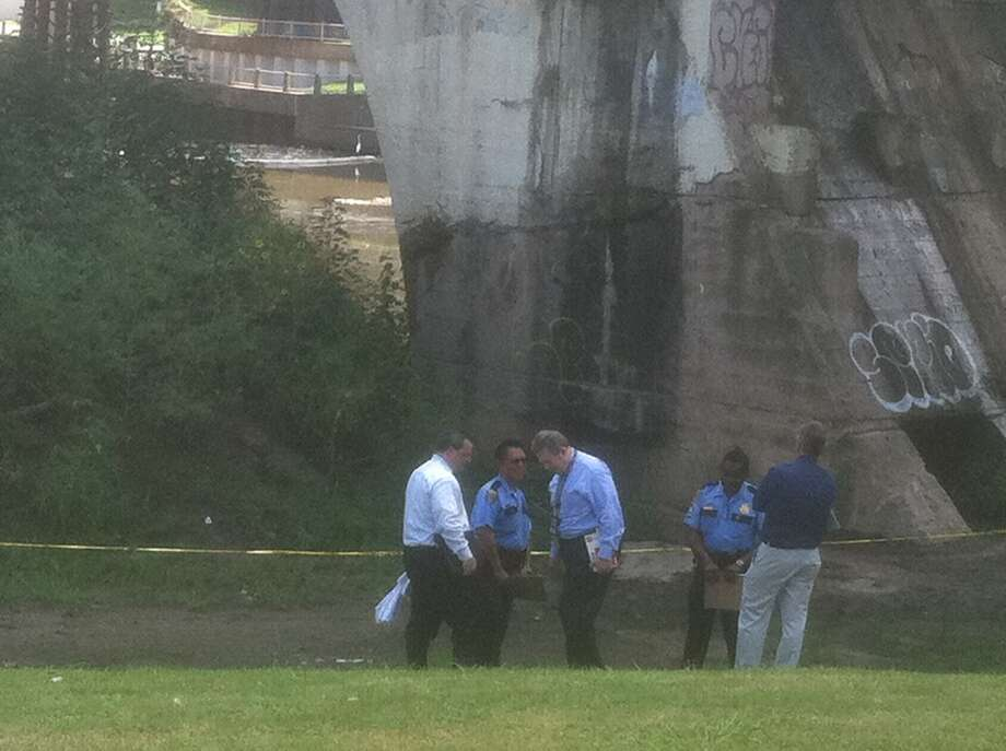 Police investigate after a body was discovered floating in a bayou downtown Wednesday morning.