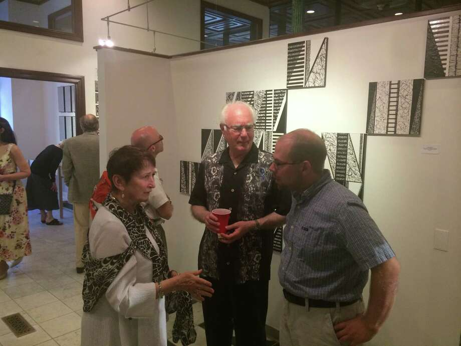 Left to right, Kay Sole, Board President Stu Horn, board member Brain Tromans. at Black and white exhibit.  Photo credit Albany Center Gallery