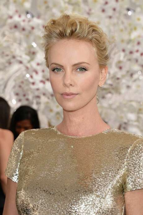 PARIS, FRANCE - JULY 07:  Charlize Theron attends the Christian Dior show as part of Paris Fashion Week - Haute Couture Fall/Winter 2014-2015 on July 7, 2014 in Paris, France.  (Photo by Pascal Le Segretain/Getty Images) Photo: Pascal Le Segretain, Staff / 2014 Getty Images