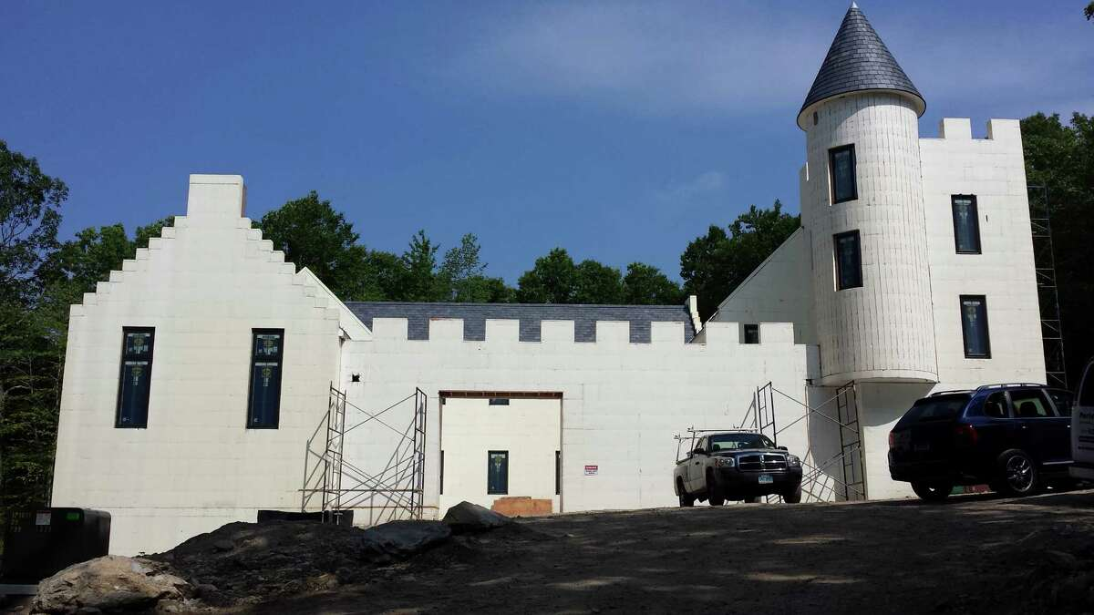 """This """"Scottish Castle"""" in New Canaan, Conn., is being built with Styrofoam blocks ó the same material used to make coolers. According to several architects, insulated concrete forms like this one are more energy efficient and durable than wood-frame walls."""