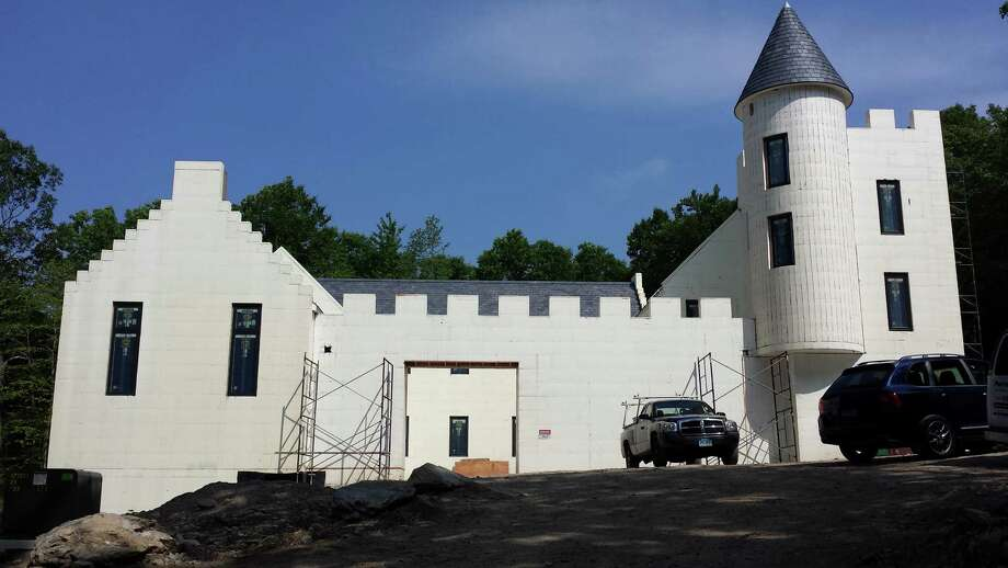 "This ""Scottish Castle"" in New Canaan, Conn., is being built with Styrofoam blocks ó the same material used to make coolers. According to several architects, insulated concrete forms like this one are more energy efficient and durable than wood-frame walls. Photo: Contributed Photo, Contributed / New Canaan News Contributed"