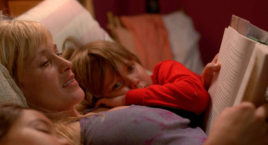 "This image released by IFC Films shows Patricia Arquette and Ellar Coltrane in a scene from the film,""Boyhood."" (AP Photo/IFC Films) ORG XMIT: NYET115 / IFC Films"