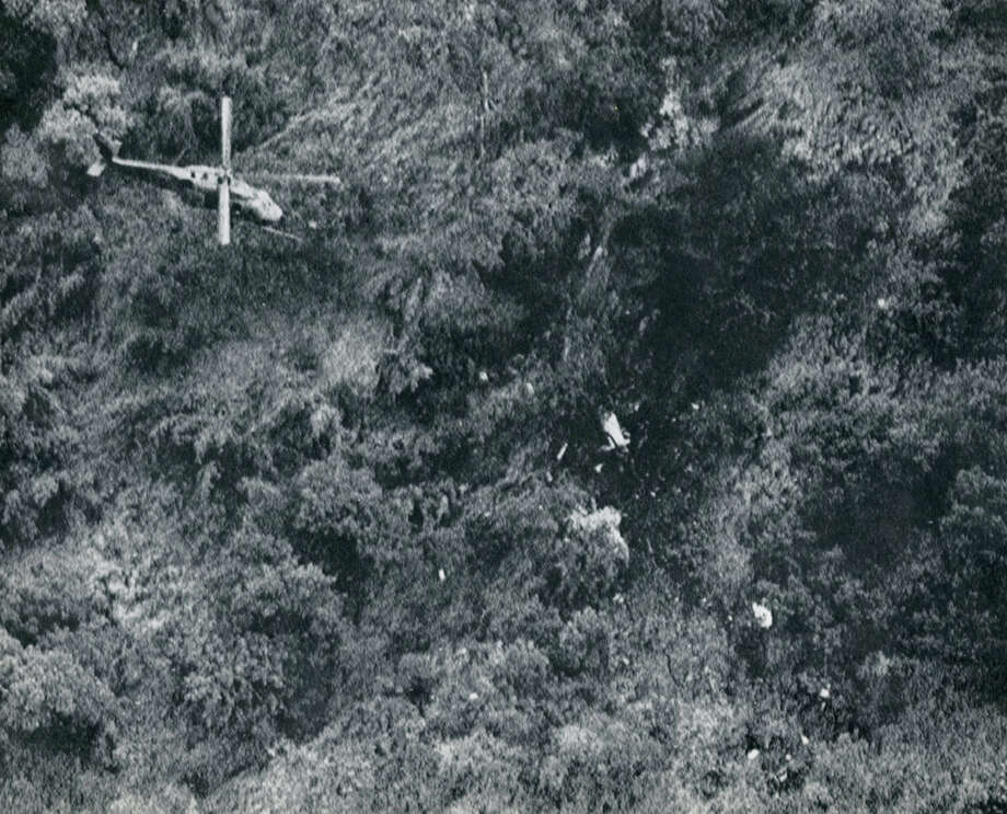 An MH-60 Blackhawk helicopter hovers over the site where a plane carrying U.S. Rep. Mickey Leland and 14 other passengers crashed in Gambela Province, Ethiopia. Leland, a Democratic congressman from Texas 18th District, died Aug. 7, 1989 at age 44 when a plane he was on crashed during a mission trip in Fugnido, Ethiopia. (Houston Chronicle / Dave Einsel) Photo: AP, UPI Photos