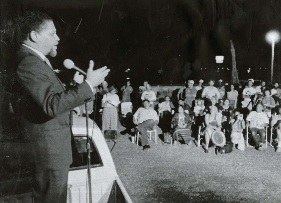 Congressman Mickey Leland speaks to the Veterans Peace Convoy to Nicaragua, June 14, 1988, in Laredo. He had spent the day negotiating with U.S. Customs agents to allow the 37 trucks to cross the border into Mexico on the trip to Nicaragua. Leland, a Democratic congressman from Texas 18th District, died Aug. 7, 1989 at age 44 when a plane he was on crashed during a mission trip in Fugnido, Ethiopia. (UPI / Bruno Torres) Photo: AP, UPI Photos