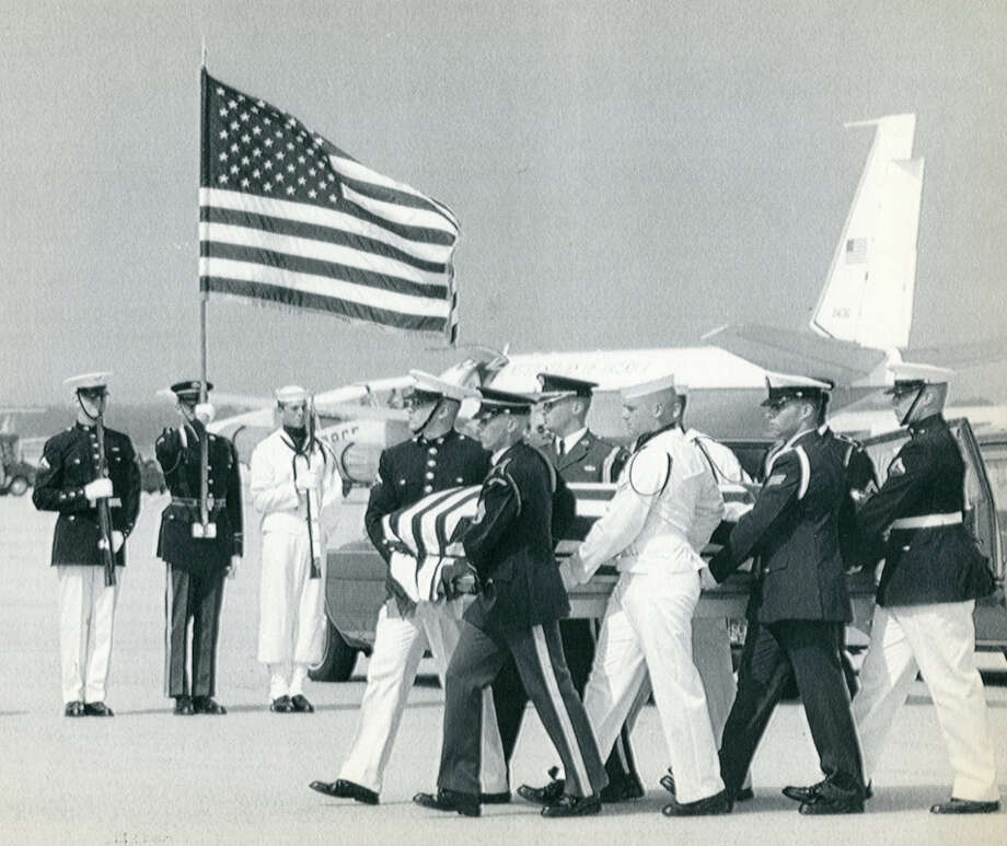 An honor guard carried U.S. Rep. Mickey Leland's casket to a hearse after arrival at Andrews Air Force Base, Aug. 23, 1989. Leland, a Democratic congressman from Texas 18th District, died Aug. 7, 1989 at age 44 when a plane he was on crashed during a mission trip in Fugnido, Ethiopia. (AP / Marcy Nighswander) Photo: AP, UPI Photos