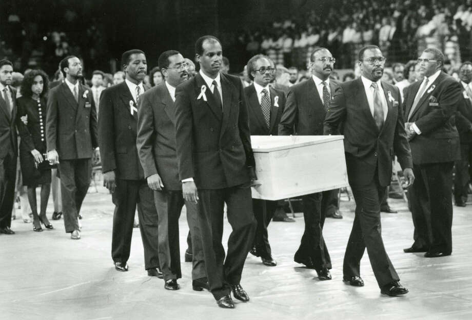 Friends and colleagues of Mickey Leland carry an empty pine casket Aug. 18, 1989, during a procession to begin a service for the dead congressman at Texas Southern University. Leland, a Democratic congressman from Texas 18th District, died Aug. 7, 1989 at age 44 when a plane he was on crashed during a mission trip in Fugnido, Ethiopia. Photo: AP, UPI Photos