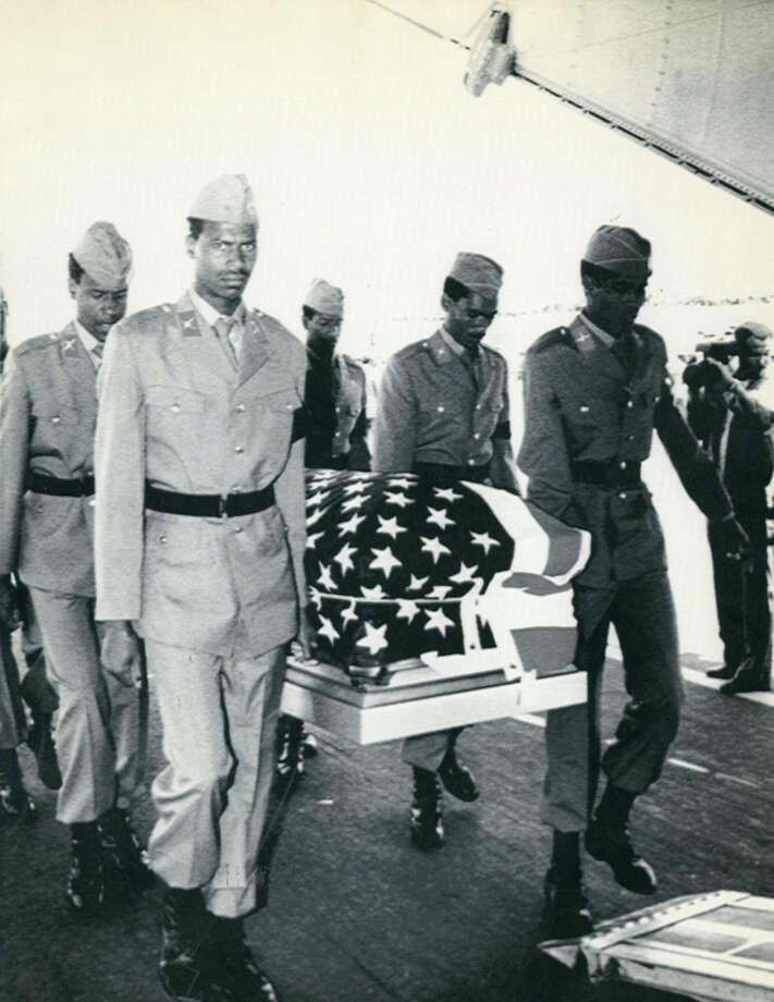 An Ethiopian honor guard carries U.S. Rep. Mickey Leland's casket aboard a U.S. Air Force plane at the Addis Ababa airport, Aug. 22, 1989. (AP / Paola Crociani)