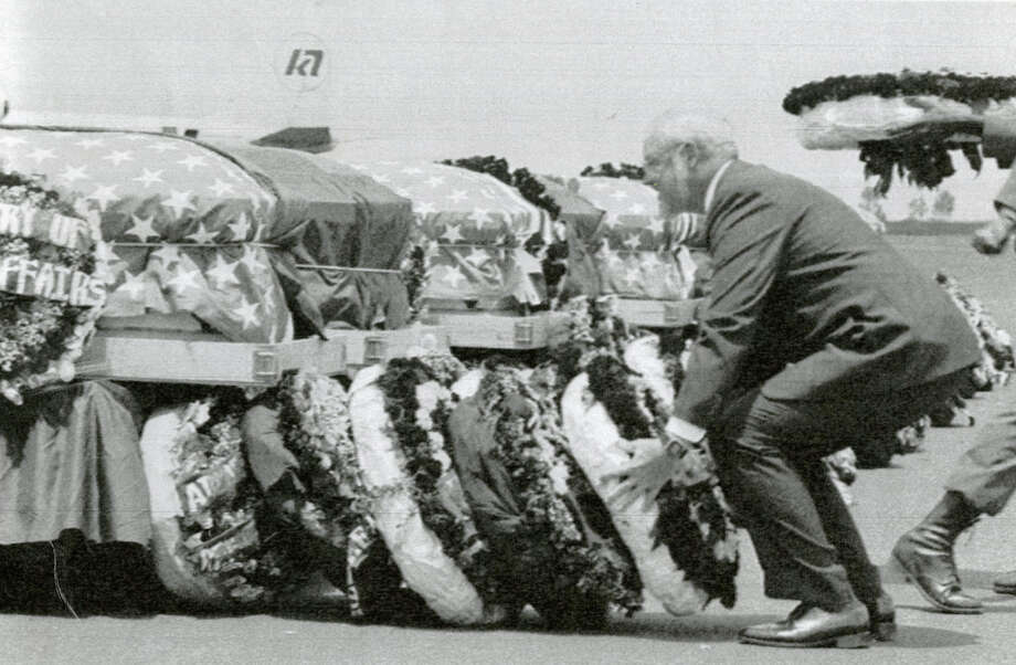U.S. Embassy Charge D'Affaires Robert Houdek lays a wreath at the foot of U.S. Rep. Mickey Leland's casket, Aug. 22, 1989, at the Addis Ababa airport. Leland, a Democratic congressman from Texas 18th District, died Aug. 7, 1989 at age 44 when a plane he was on crashed during a mission trip in Fugnido, Ethiopia. (Photo: Dave Einsel) Photo: AP, UPI Photos