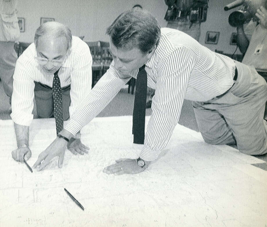 Consultant Martin LaVor, left, and Jeffrey Clark, former Mickey Leland staffer, review a map of Ethiopia during the search for Leland's plane. Leland, a Democratic congressman from Texas 18th District, died Aug. 7, 1989 at age 44 when a plane he was on crashed during a mission trip in Fugnido, Ethiopia. (AP / Marcy Nighswander) Photo: AP, UPI Photos