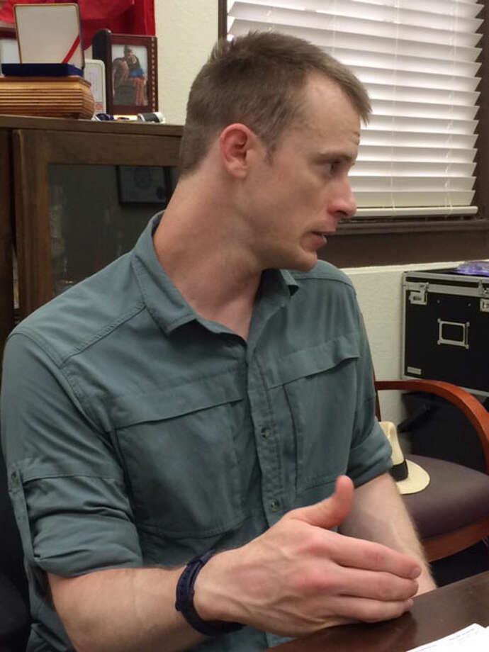 Wearing civilian clothing, Sgt. Bowe Bergdahl sits at an office on Joint Base San Antonio-Fort Sam Houston early Wednesday, Aug. 6, 2014. Bergdahl was questioned by a two-star general charged with investigating his disappearance from a base in Afghanistan nearly five years ago. Courtesy photo / Eugene Fidell