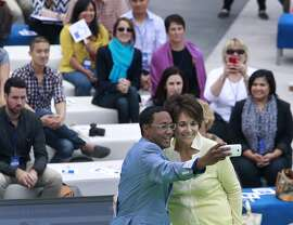Featured speaker and emcee Mario Armstrong shoots a selfie with Rep. Anna Eshoo at a conference for small business owners at Facebook's headquarters in Menlo Park, Calif. on Tuesday, Aug. 5, 2014. The Facebook Fit bootcamp at the social network's campus capped a five-city tour designed to help small businesses maximize their opportunities on the web.