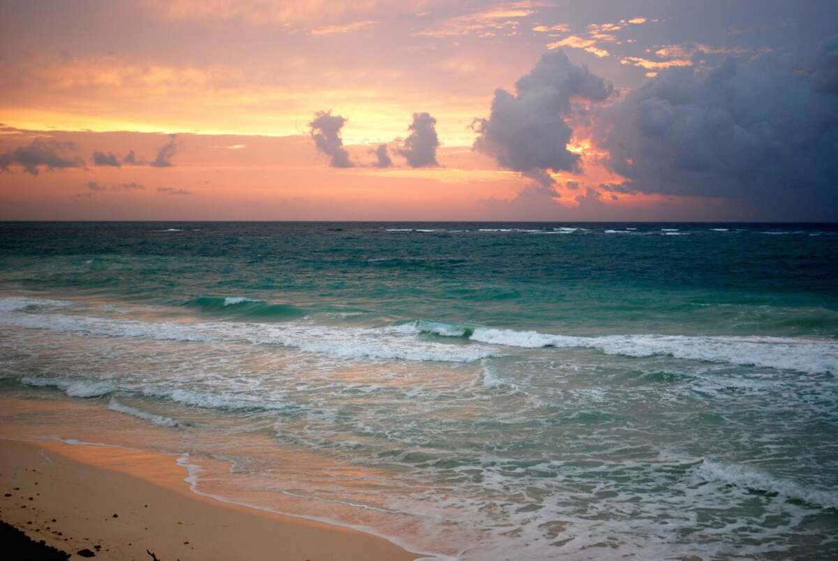 The rising sun illuminates the coastline of Sian Ka'an, which is roughly translated as 'the place where the sky was born' in Mayan.