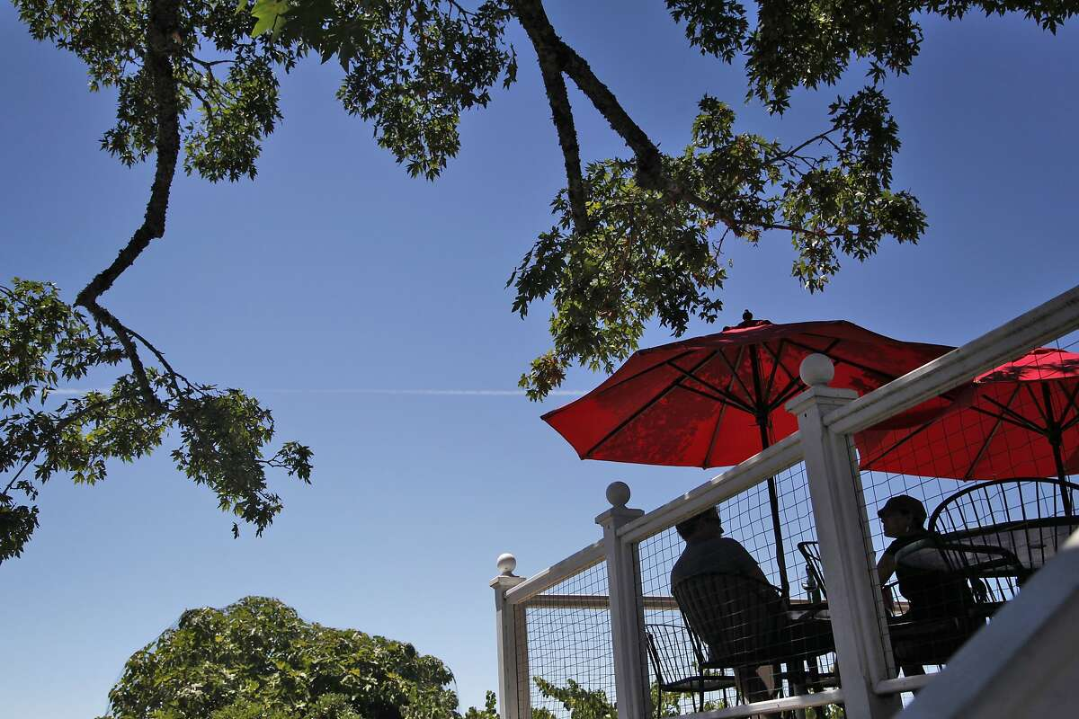 People enjoy the views from the tasting room's patio at Burrell School in Los Gatos, Calif., on Thursday, July 31, 2014.