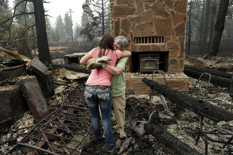 Fire claims Fireside Village:Donna Garner (right) embraces former employee Napua Gonsales-Merck while sifting through the   remains of the Fireside Village, a restaurant and shop owned by the Garners for over 30 years in   Hat Creek, Calif. Light rain and higher humidity aided crews battling two wildfires just miles apart in the Northern   California forest. Photo: Marcio Jose Sanchez, Associated Press