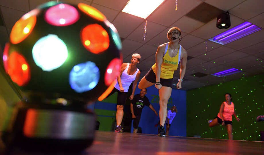 Bokwa instructor Lisa Stone leads a session at the Brickhouse Cardio Club recently. The sessions feature dance-club lighting. Photo: Robin Jerstad