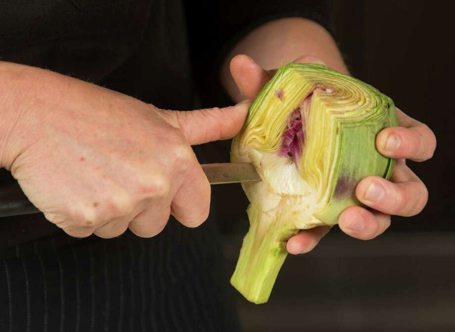 """This would be your artichoke heart, and you just peel that away and eat it,""  H-E-B culinary nutritionist Charlotte Samuel says. Photo: William Luther, San Antonio Express-News / © 2014 San Antonio Express-News"