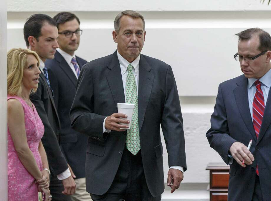 House Speaker John Boehner and GOP leaders have shown no interest in impeaching President Obama, but Democrats have fanned the flames on the topic to energize their base. Photo: J. Scott Applewhite / Associated Press / AP