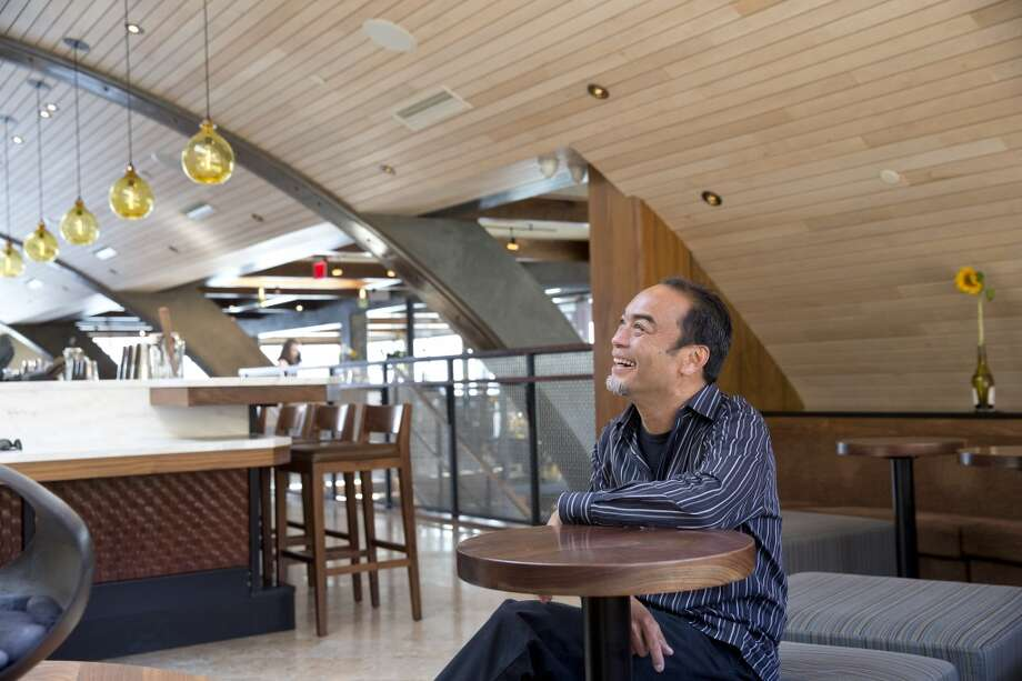 Designer  Eduard Llora sits for a portrait in the Barrel House Tavern in Sausalito, Calif., on Friday, July 19, 2013.  Llora restored the historic building while designing the new restaurant and bar and preserved features such as the the barrel shaped ceiling. Photo: Laura Morton, Special To The Chronicle