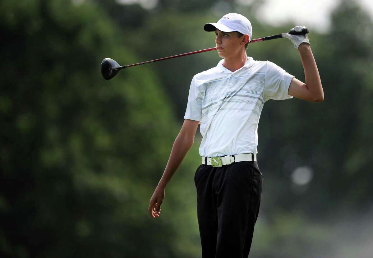 Adam Friedman, of Westport, watches his shot on the 14th hole Wednesday Aug. 6, 2014, during the Borck Memorial Junior Golf Tournament at the Brooklawn Country Club in Fairfield, Conn.