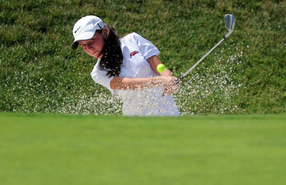 Sarah Vimini, of Fairfield, chips it out of the sand on the 9th hole Wednesday Aug. 6, 2014, during the Borck Memorial Junior Golf Tournament at the Brooklawn Country Club in Fairfield, Conn. Photo: Autumn Driscoll / Connecticut Post