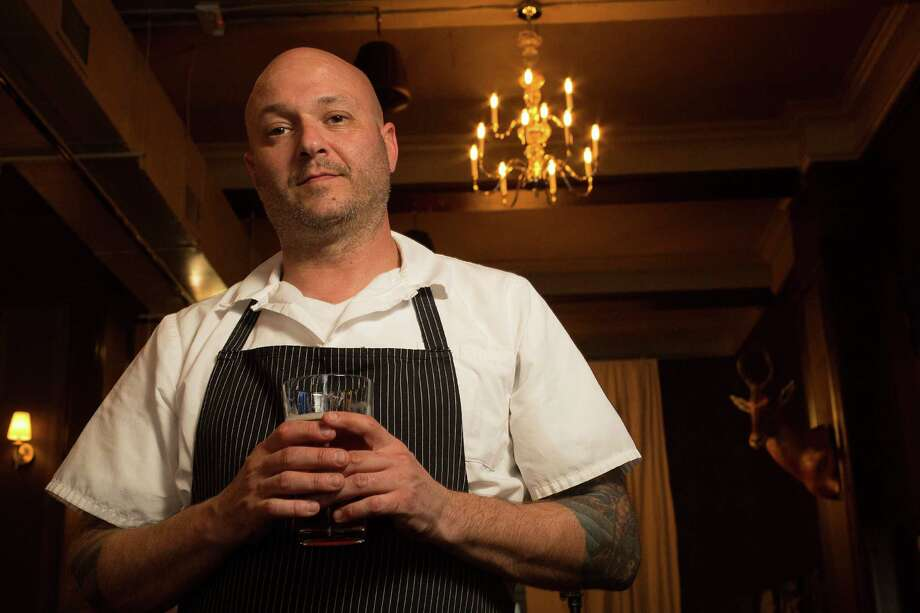 Seth Greenburg at Springbok in downtown Houston. Greenburg moved to Houston from Los Angeles to create an upscale pub menu for the operation that is inspired by South African cuisine and culture. Photo: Johnny Hanson, Staff / © 2014  Houston Chronicle