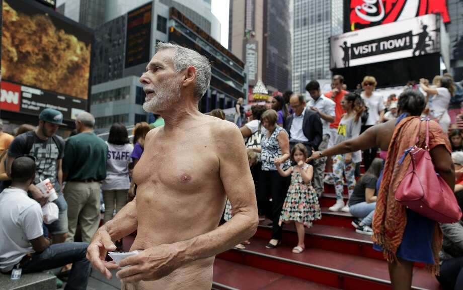 George Davis, a candidate for the San Francisco Board of Supervisors, makes a speech in the nude on Times Square, Wednesday, Aug. 6, 2014. Photo: Julie Jacobson, Associated Press