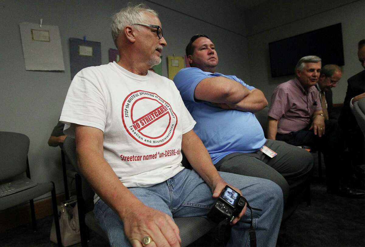 Streetcar project opponents Michael Dennis (left) and Steve Moody attend the City Council B Session to learn the results of a petition drive to put the VIA Metropolitan Transit's streetcar project to a vote on Wednesday, August 6, 2014.