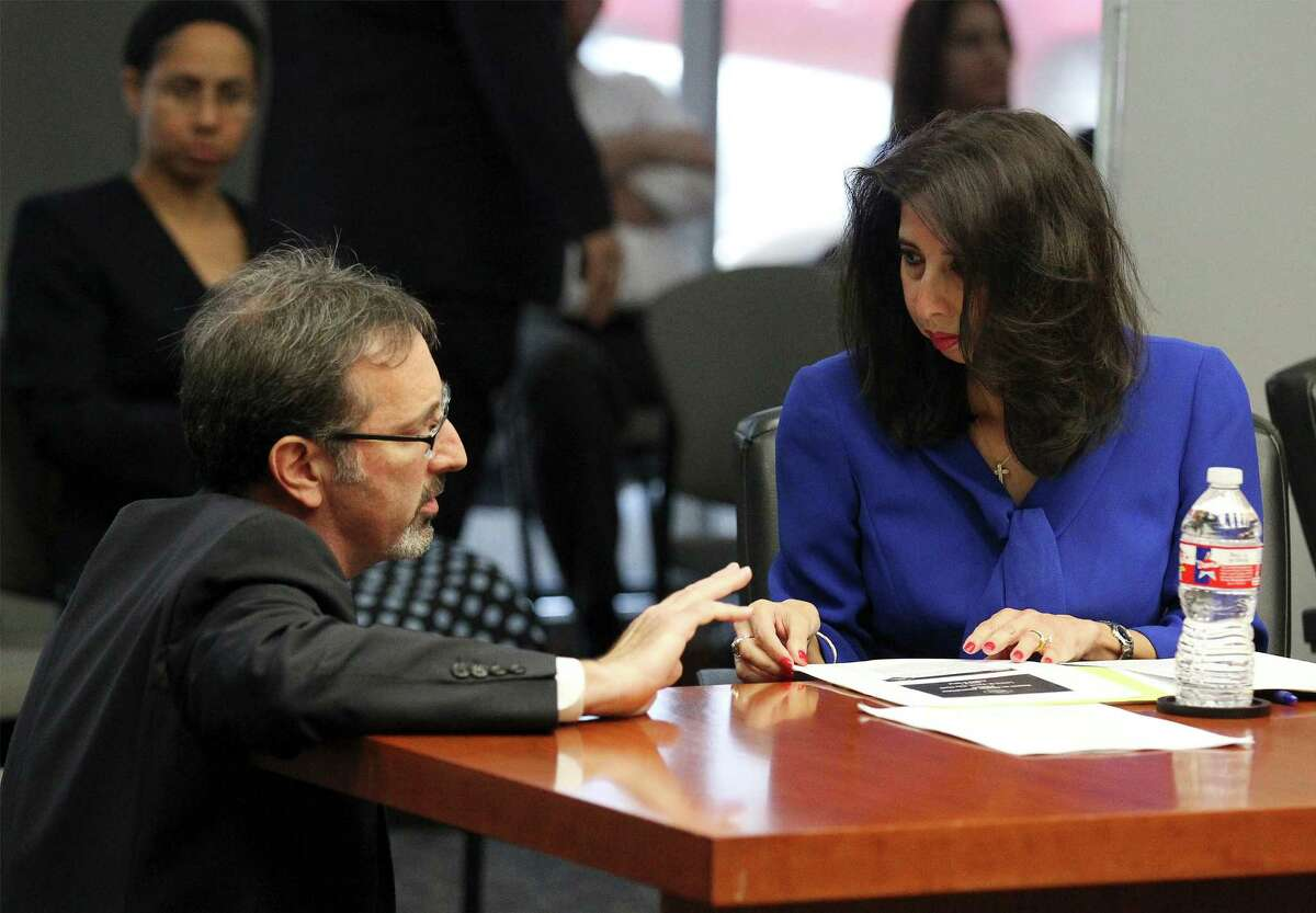 City Clerk Leticia Vacek (right) and City Attorney Robbie Greenblum chat before the City Council B Session which reveals the results of a petition drive to put the VIA Metropolitan Transit's streetcar project to a vote on Wednesday, August 6, 2014.