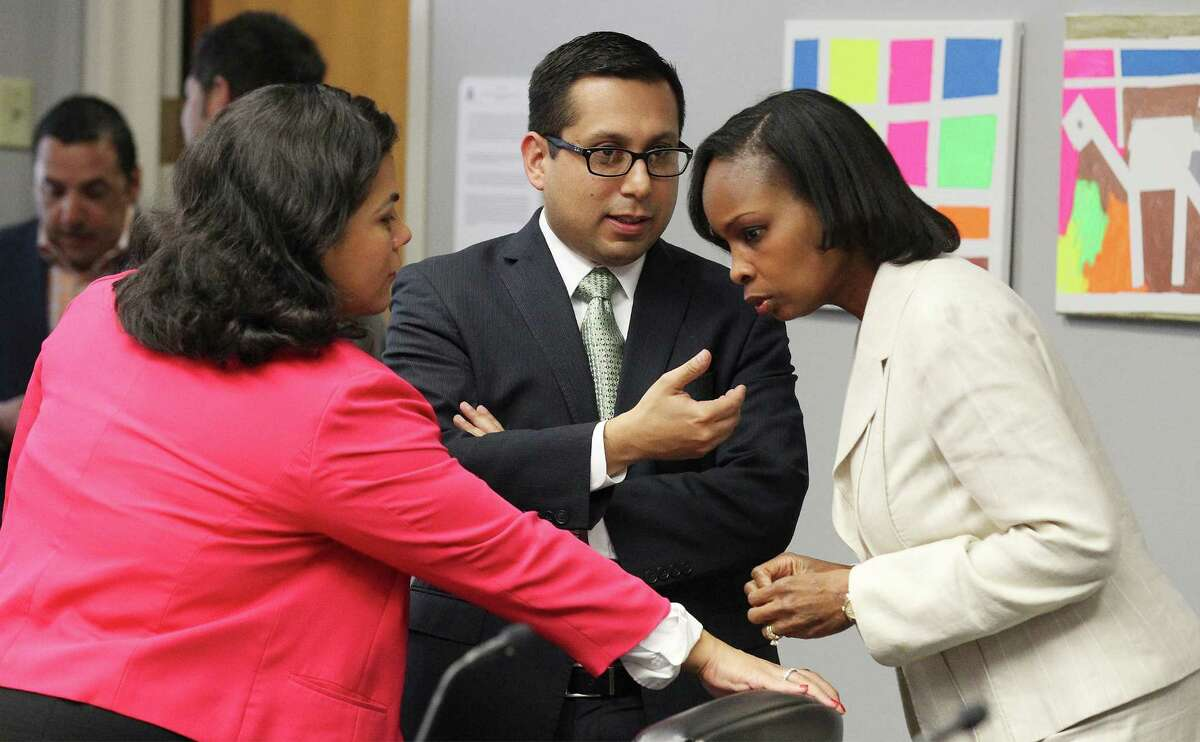 District 3 Council person Rebecca J. Viagran (from left), District 1 Councilman Diego M. Bernal and Mayor Ivy Taylor talk before the City Council B Session to learn the results of a petition drive to put the VIA Metropolitan Transit's streetcar project to a vote on Wednesday, August 6, 2014.