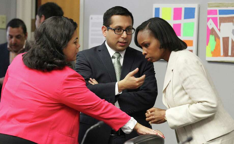 District 3 Council person Rebecca J. Viagran (from left), District 1 Councilman Diego M. Bernal and Mayor Ivy Taylor talk before the City Council B Session to learn the results of a petition drive to put the VIA Metropolitan Transit's streetcar project to a vote on Wednesday, August 6, 2014. Photo: Kin Man Hui, San Antonio Express-News / ©2014 San Antonio Express-News